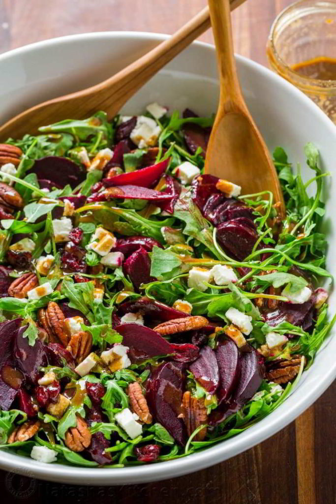 beet salad with wooden spoons
