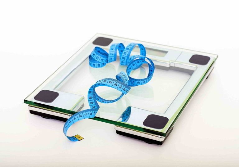 weight loss scale with measuring tape