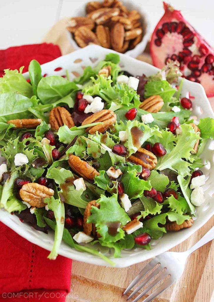 Mixed green salad with pomegranate pecans and feta