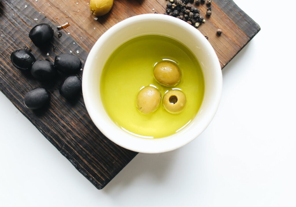 Olive oil with olive fruit